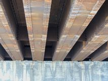 Steel beams on concrete rusting view under car road bridge in Indianapolis Indiana. USA Stock Images