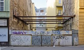 Steel beams in a gap between two houses, Stock Images