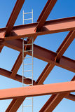 Steel beams and ladder against the blue sky Royalty Free Stock Photo