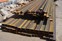 Steel beams for roofing. Rust steel channel bunch on house construction site outdoor. Stock Photography