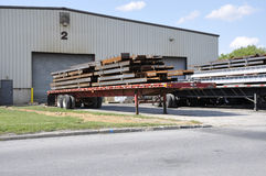 Steel beams on trucks Royalty Free Stock Photography