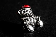 Steel bear in  red hat, macro photo stock photography
