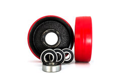 Steel bearings and red wheels. Red wheels and steel bearings isolated on a white background Stock Photo