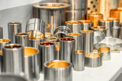 Steel bearings. Steel bushings with bronze coating inside. Abstract industrial background royalty free stock image