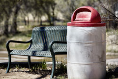 Steel bench and plastic rubbish waste can bin Royalty Free Stock Photos
