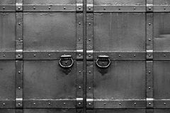 Steel black gates. Symmetrical and . Abstract black and white background with correct geometric proportions Royalty Free Stock Photos