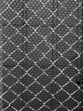 Steel and black plastic net Stock Image