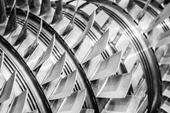 Steel blades of turbine propeller. Close-up view. In B/W. Selected focus on foreground Royalty Free Stock Photos