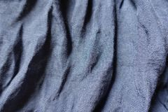 Blue cotton and polyester fabric in soft folds. Steel blue cotton and polyester fabric in soft folds Royalty Free Stock Photo