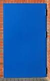 Steel blue door brick house Stock Photo