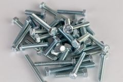 Bolts arranged in a pile royalty free stock photos