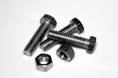 Bolts and nuts. Steel bolts and nuts on white background close-up. B&W Royalty Free Stock Photos
