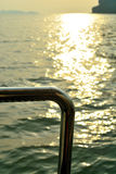 Steel of bottom boat golden sunlight on water Stock Photo