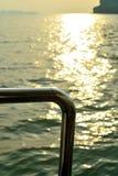 Steel of bottom boat golden sunlight on water. A steel of bottom boat and golden sunlight on water befor sunset Stock Photo