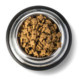 A Steel Bowl full of dog-food. Stock Images