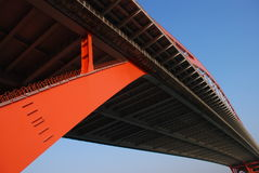 steel bridge. Orange steel bridge,blue sky,curve into the sky Stock Images