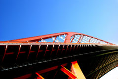 Steel bridge. A steel bridge stretching to the blue sky Stock Images