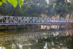 Steel bridge across the pond. At thailand Stock Image
