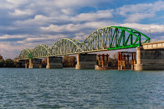 Steel bridge across river Royalty Free Stock Photo