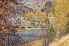 Steel bridge in Autumn. Stock Photo