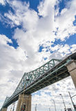 Steel bridge on blue sky with some clouds Royalty Free Stock Photos