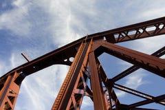 Steel Bridge Detail. Industrial steel bridge detail with sky and clouds royalty free stock photo