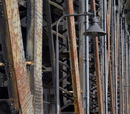 Steel bridge girders with lamp. Rusty riveted steel bridge girders Royalty Free Stock Images