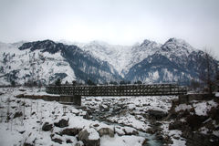 Steel bridge on mountain and snow. Old steel road bridge over river in Indian Stock Photography