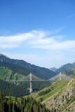 Steel bridge in the mountains Royalty Free Stock Image