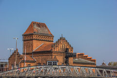 Steel bridge and old building in Lubeck Stock Photography