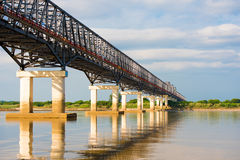 Steel bridge over the Irrawaddy river in Mandalay, Myanmar, Burma. Copy space for text. Stock Photo