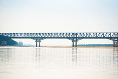 Steel bridge over the Irrawaddy river in Mandalay, Myanmar, Burma. Copy space for text. Royalty Free Stock Photos