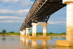 Steel bridge over the Irrawaddy river in Mandalay, Myanmar, Burma. Copy space for text. Royalty Free Stock Photography