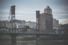 Steel bridge over river in city Royalty Free Stock Photos