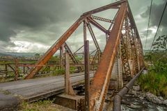 Steel bridge over a river in Costa Rica stock image