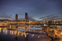 Steel Bridge Over Willamette River at Blue Hour Stock Photos