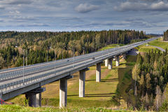 Steel bridge overpass on concrete piers, highway crosses Russian Stock Photos