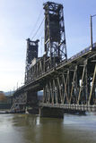 Steel bridge & a passing barge. Royalty Free Stock Image