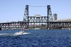 Steel bridge and a passing boat. A steel bridge near the city industrial area Stock Images