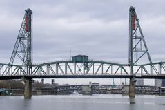 Steel bridge spanning the Columbia River. Steel bridge with arches spanning the Columbia River with cityscape in the background Royalty Free Stock Photo