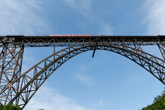 Steel-Bridge with train. A look to the Muengstener train bridge. Built 1894-1897 with 5.000 tons of steel. Length 465 m, height 107 m crossing the river wupper Royalty Free Stock Image