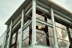 Steel building architecture. A steel building with metal straps and large glass windows Stock Image