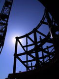 Steel building beams. Silhouetted steel structure and support beams of a building under construction Stock Image