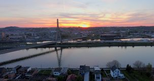 Steel Cable Bridge. Aerial view of steel cable bridge crossing in Belgium. Road in perspective. European bridge over a river at sunset stock footage