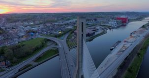 Steel Cable Bridge. Aerial view of steel cable bridge crossing in Belgium. Road in perspective. European bridge over a river at sunset stock video