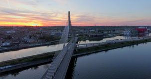 Steel Cable Bridge. Aerial view of steel cable bridge crossing in Belgium. Road in perspective. European bridge over a river at sunset stock video footage