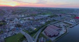 Steel Cable Bridge. Aerial view of steel small belgian town at sunset stock video