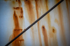 Steel cable. Heavy stealcable in front of a rusty ship Stock Photography