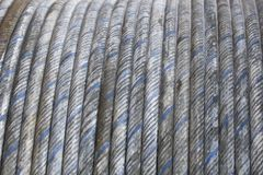 Steel cable rolled. Steel cable coiled with blue stripes Royalty Free Stock Photography
