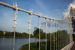 Steel cable of suspension bridge in city park at Udon Thani, Tha Royalty Free Stock Images